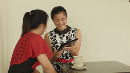 Young Asian Women In a Cafe With a Tablet Computer Footage