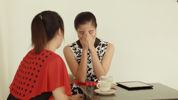 Young Woman Consoling Her Sad Friend at a Cafe Footage