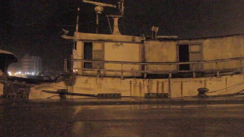 Ghostly boat at harbor during a typhoon with stron Footage