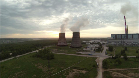 Flight to Cooling Towers at Dawn Footage