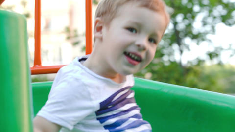 Happy child on slide outdoor Stock Video Footage