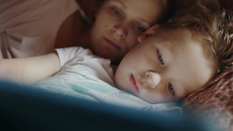Mother and son with pad before bedtime Stock Video Footage