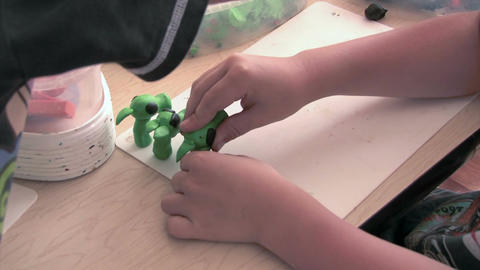 Boy sculpts from plasticine Stock Video Footage