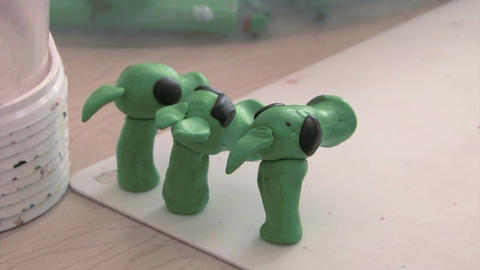 Boy Sculpts From Plasticine stock footage
