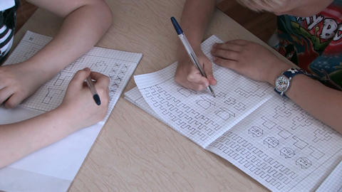 Children write in notebooks Live Action