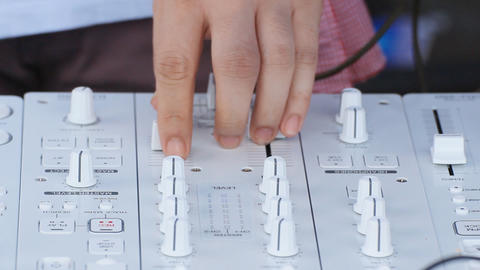 hands adjusting DJ equipment controller Stock Video Footage