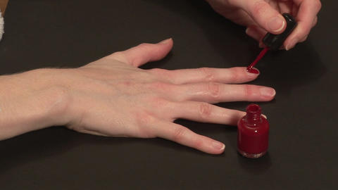 Stock Footage of a woman Painting her Nails Live Action