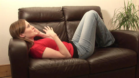 Woman Sitting on Couch Footage