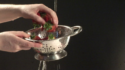 Stock Footage Of Cleaning Strawberries stock footage