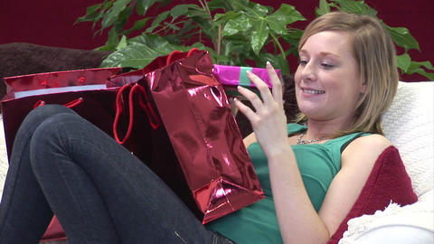 Woman on Sofa with Christmas Presents Stock Video Footage