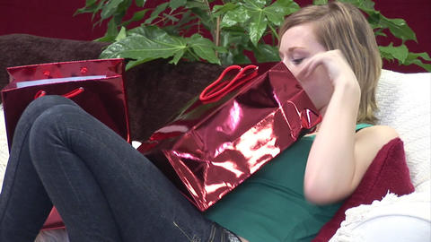 Woman on Sofa with Christmas Presents Footage