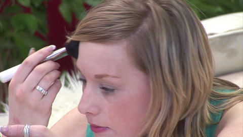 Woman Putting on make up Stock Video Footage