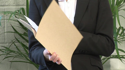 Business woman examining a Document Stock Video Footage