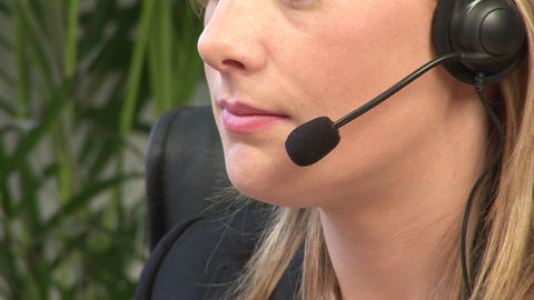 Attractive Blonde on Headset Stock Video Footage