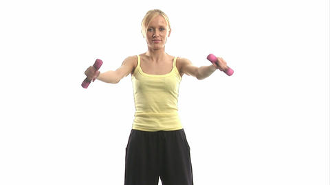 Young Woman Exercising With Dumbells stock footage
