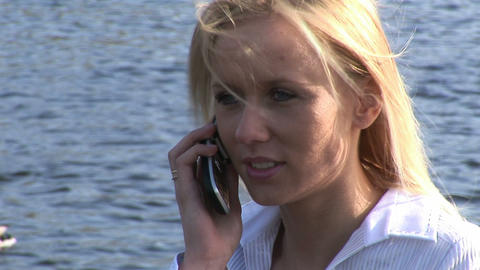 Young woman talking on cellphone Stock Video Footage