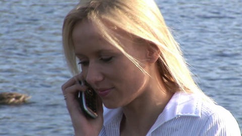 Young woman talking on cellphone Footage