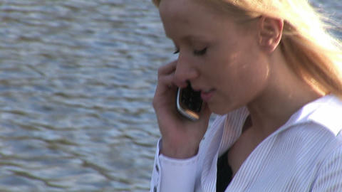 Young woman talking on cell phone Stock Video Footage