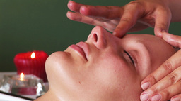 Woman getting her face massaged Footage