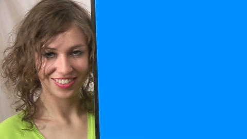 Woman in Front of Blue Screen 1 Footage