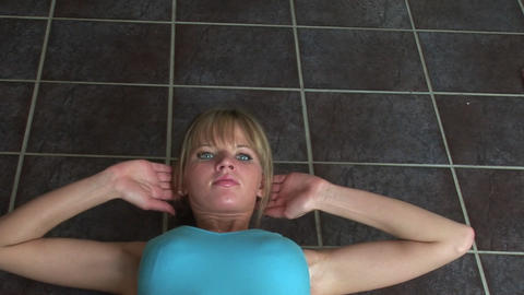 Woman at home Doing situps Footage