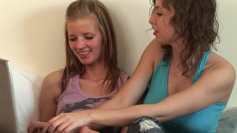 Two girls in bedroom on Computer Stock Video Footage