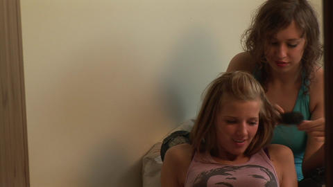 Two Girls having fun Combing hair Stock Video Footage