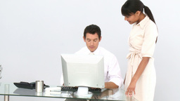 Business coworkers at a computer Footage