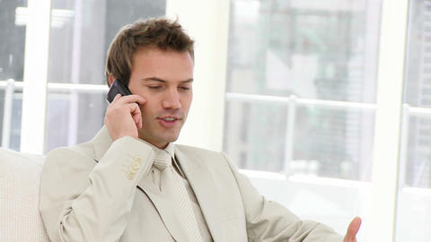 Charismatic Businessman on phone Stock Video Footage
