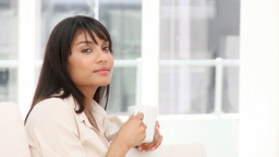 Attractive businesswoman drinking a coffee Footage