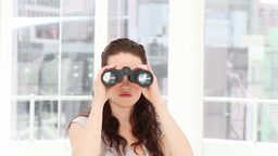 Serious businesswoman looking through binoculars Stock Video Footage
