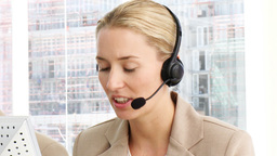 Business woman working in a call centre Stock Video Footage
