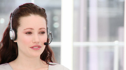 Charismatic woman using a headset Footage