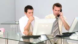 Two businessmen working at a computer Stock Video Footage