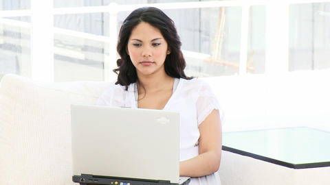 Young business woman working at a laptop Stock Video Footage