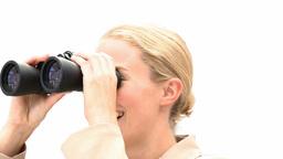 Blond business woman holding binoculars Footage