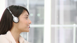 Assertive businesswoman talking on headset Footage