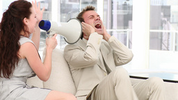 Young businesswoman yelling through a megaphone in Stock Video Footage
