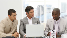 Serious businessmen working at a computer Footage