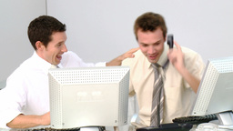 Happy businessmen celebrating a success Stock Video Footage