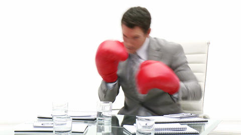 Competitive business man holding boxing gloves Footage