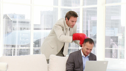 Furious business man punching his colleague Stock Video Footage