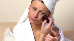 Beautiful woman putting blush Stock Video Footage