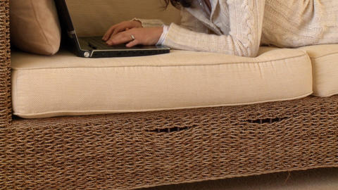 Mirthful woman lying down using a laptop Stock Video Footage