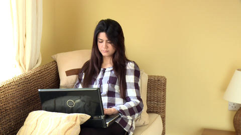Concentrated woman looking at her laptop Footage