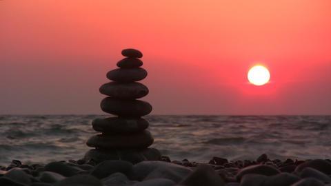 pyramid on beach with sun Stock Video Footage
