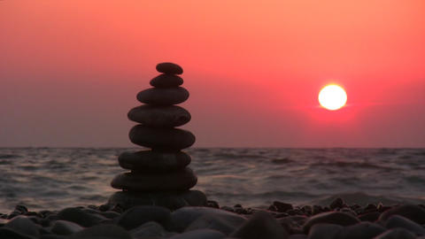 pyramid on beach with sun Footage
