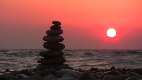 pyramid on beach with sun Stock Video Footage