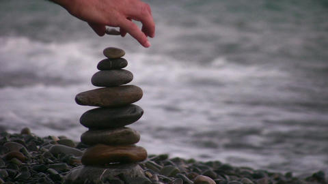 hand making pyramid on beach Stock Video Footage