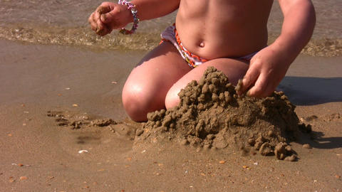 hands of little girl play with sand on beach Footage